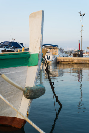Photo of The small harbour of the Murter city on the island Murter in Croatia with wooden fishing boats