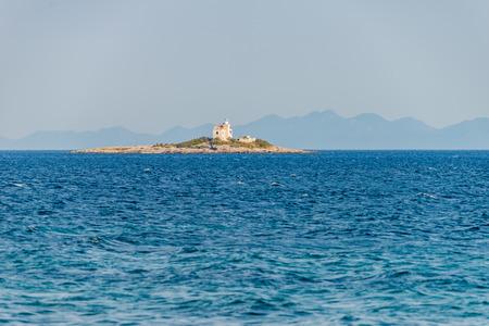 Photo of Beautiful summer seascape with lighthouse on the island in Orebic, Peljesac peninsula, Dalmatia, Croatia