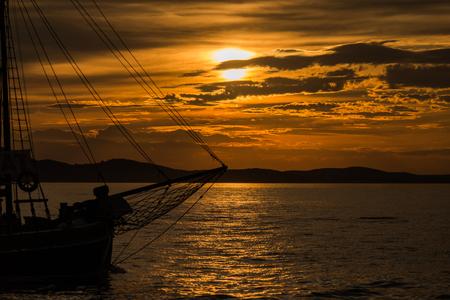 Photo of sunset in Zadar, Dalmatia, Croatia with wooden ship Zdjęcie Seryjne