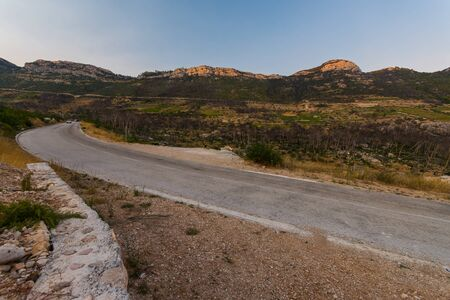 Photo of road to small village Trstenik in Peljesac peninsula, with mountins and blue sky as background Zdjęcie Seryjne