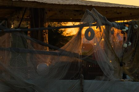 Photo of fish nets on wooden stakes on sunset in Murter, Dalmatia, Croatia