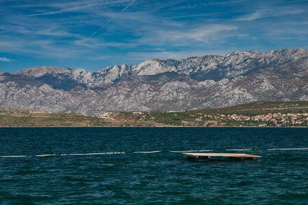 Photo of Velebit moutains and Adriatic Sea from Novigrad, Dalmatia, Croatia