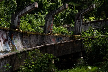 SARAJEVO, BOSNIA AND HERCEGOVINA - AUGUST 28, 2019: Abandoned Olympic Bobsleigh and Luge Track, built for the Olympic Winter Games in 1984 Redactioneel