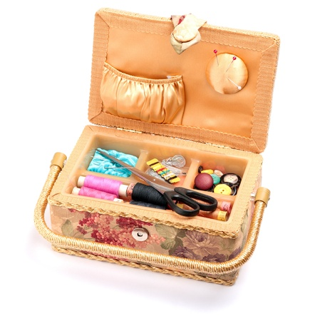 sewing box: Sewing box with scissors,needles, pins, buttons and  threads  isolated on white background