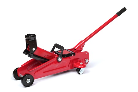 Red hydraulic floor jack isolated on white background photo