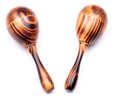 mexican background: Two wooden maracas with a typical wood structure isolated on white background