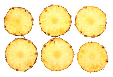 fresh pineapple slices isolated on white background photo