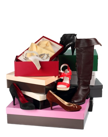Female shoes and cardboard boxes isolated on white background photo