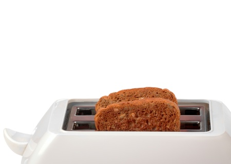 Toaster with two bread slices isolated on white background photo