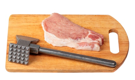 Pork stake on a wooden board with a meat hammer Stock Photo - 13878688