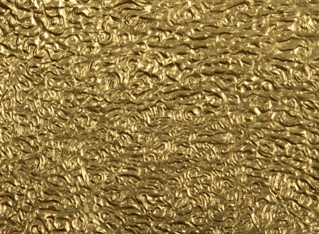 Closeup gold foil surface for background photo
