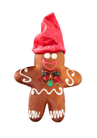 Ginger bread with red cap isolated on white  photo