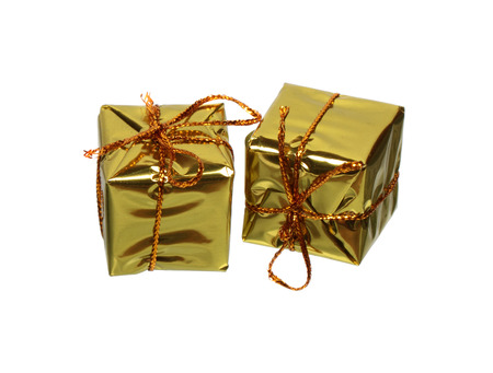 Two golden gift boxes isolated on white background Stock Photo - 24985514