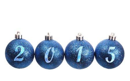 Four blue spangled christmas balls arranged in the year 2015 isolated on white background photo