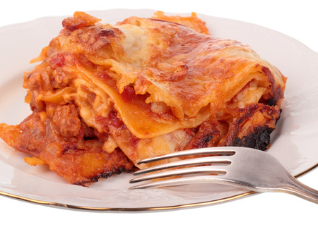 sauce dish: Lasagna in plate isolated on white background