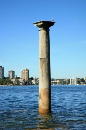 sandstone column standing in the water