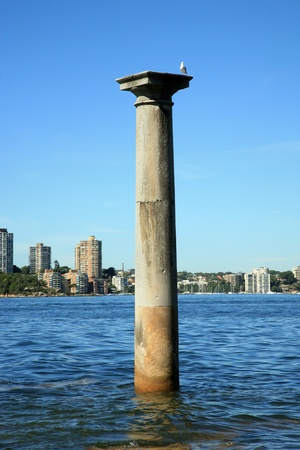 sandstone column standing in the water