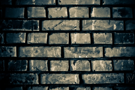Cracked brick wall in shades of gray photo