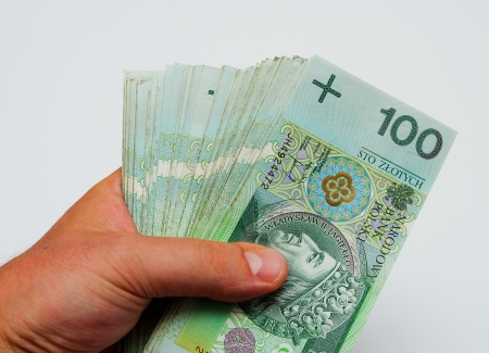 repayment: A lot of polish zloty banknotes held in male hands
