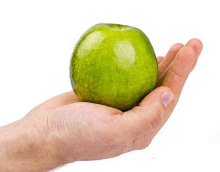 Green apple on hands