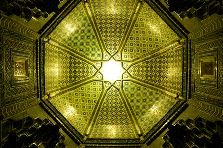 samarkand: Sun shining though a green mosaic in the ceiling, Samarkand  Stock Photo