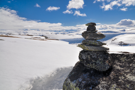 Tower made on rocks on a mossy mountain in Norway photo