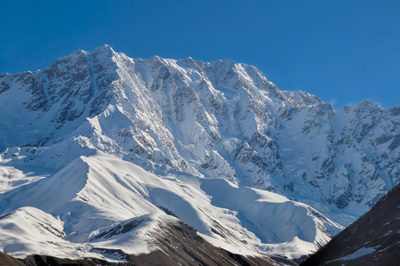 Sunlit mountains covered in snow between Mestia and Ushguli photo