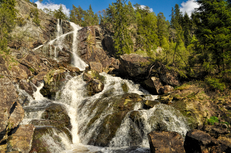 Picturesque view of the waterfall on the borderline between Sweden and Norway  photo