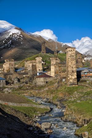 mestia: Group of houses lying on a bank on the way from Mestia to Ushguli Stock Photo