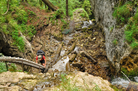 Bottom-down view of a hiker climbing a wooden ladder in Slovak Paradise National Park Stock Photo