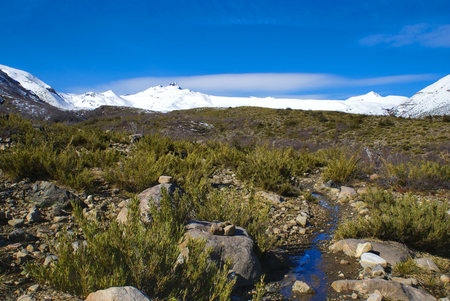 siete: Picturesque view of the snow-covered moutains and rocks of Radal Siete Tazas National Park in Chile        Stock Photo