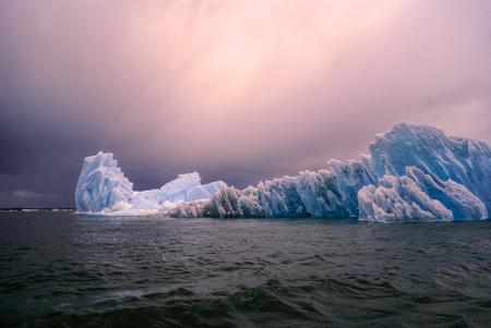 san rafael: Sun setting down over glaciers in San Rafael Lagoon in Chile Stock Photo