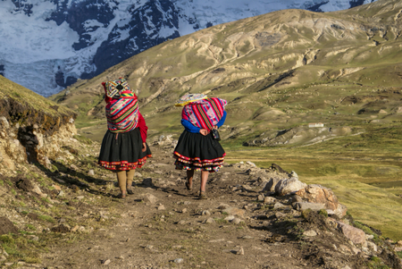 Close-up view of two Peruvian woman walking along the path in Peruvian Andes          Standard-Bild
