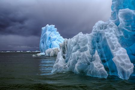 san rafael: Glaciers floating in the ocean               under cloudy grey sky in Laguna San Rafael
