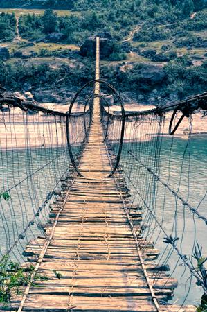 arunachal pradesh: Scary shaky long footgbridge in Arunachal Pradesh region in India Stock Photo