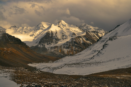 Scenic view of cloudy Wakhan valley in Tajikistan with snowy mountain peaks of Pamir and Karakoram