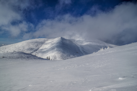 passing over: Picturesque view of clouds passing over snowy slopes