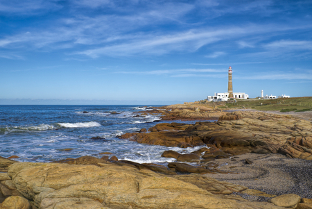 Picturesque view of a lighthouse standing on the coast in Cabo Polonio Standard-Bild