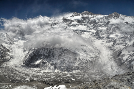 passing over: Close-up view of clouds passing over Kangchenjunga in Nepal