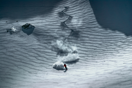Amazing view of a skier riding down the piste