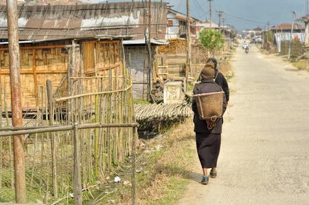 arunachal pradesh: People walking along the street in a poor quarter in Arunachal Pradesh, India