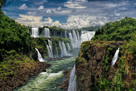 fall scenery: Dramatic view of Iguazu waterfalls in Argentina with stormy clouds in the background