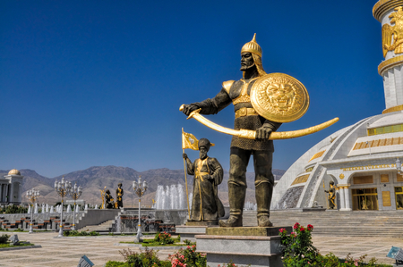 Statues around monument of independence in Ashgabat, capital city of Turkmenistan