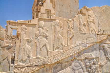 fars: Figures on walls of ancient persian capital Persepolis in current Iran Stock Photo