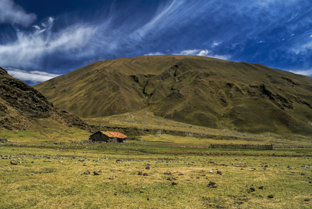 alpamayo: Picturesque green valley in between hills of Peruvian Andes Stock Photo
