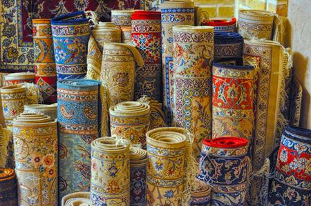 Rolls of persian carpets in Iran Standard-Bild