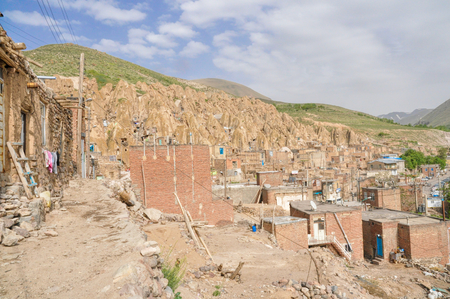 troglodyte: Scenic view of unusual cone shaped dwellings in Kandovan village in Iran
