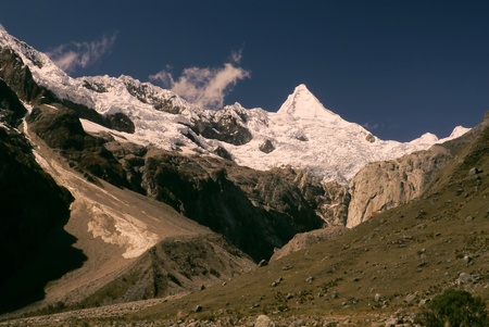 Picturesque valley below Alpamayo, one of highest mountain peaks in Peruvian Andes, Cordillera Blanca