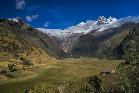 alpamayo: Picturesque green valley in between scenic mountain peaks of Peruvian Andes Stock Photo