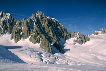 Breathtaking view of snowy mountains from the top in Valle Blanche photo